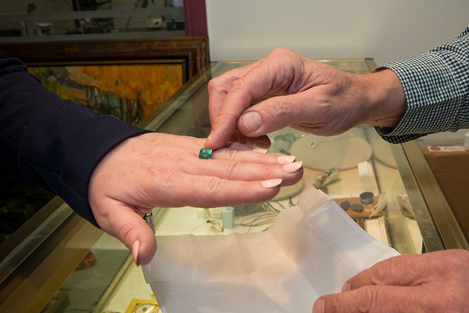 Gerry is trying the gem on a hand of a client