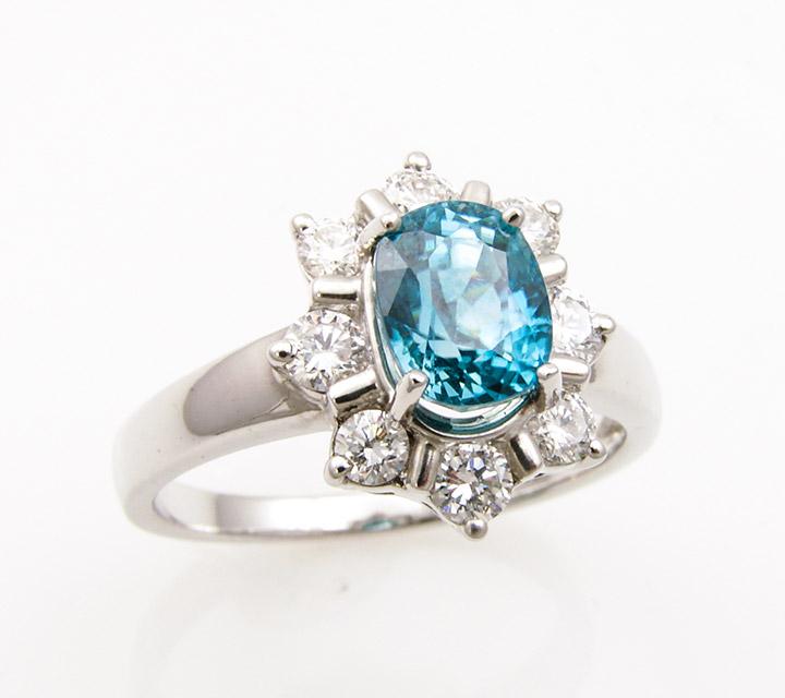 ring with Ceylon blue zircon and side diamonds