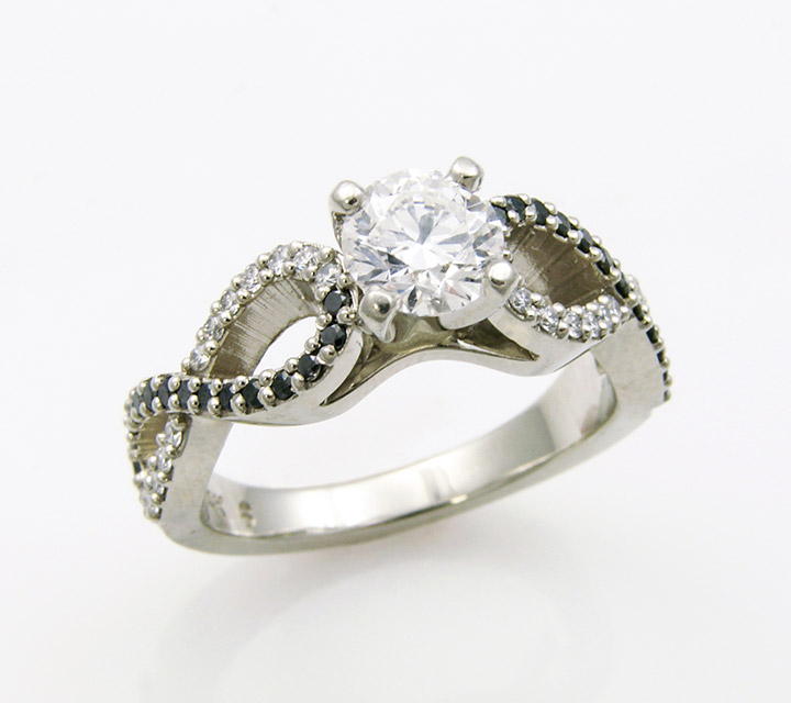 white gold custom made engagement ring with one diamond