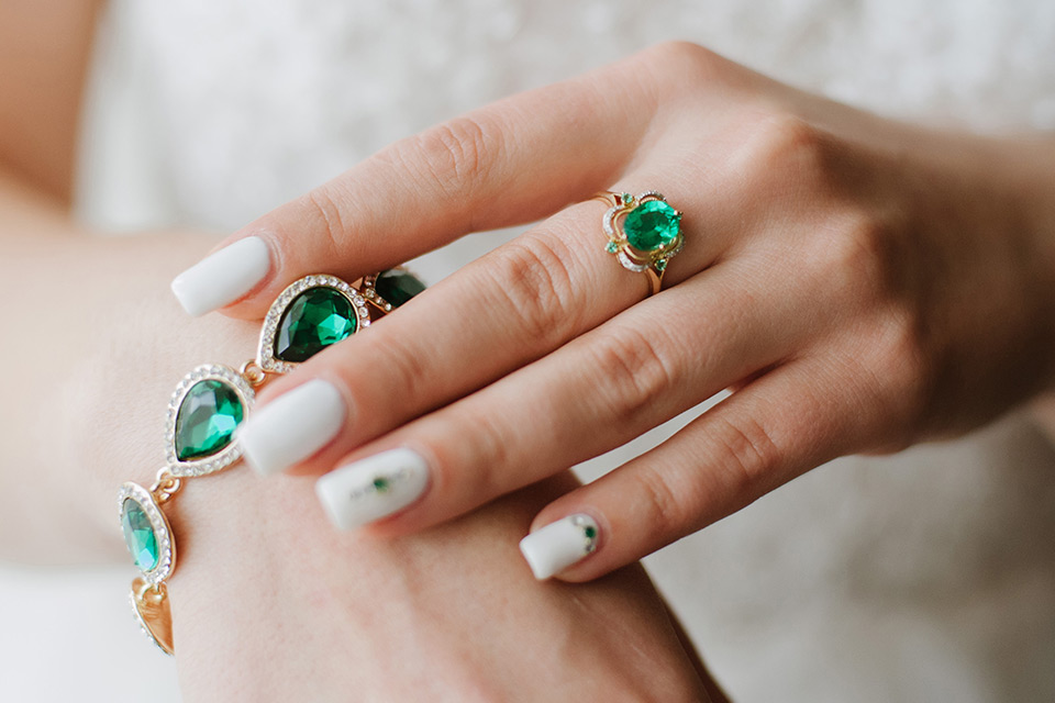 Woman's hand with jewellery gems, coloured stones
