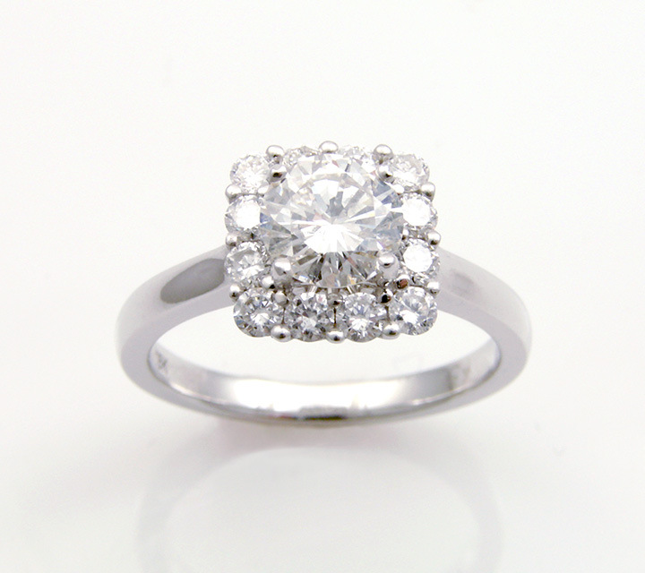 white gold square haloed engagement ring with diamonds