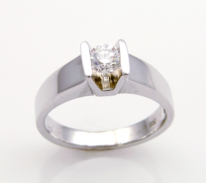 white gold engagement ring with one diamond